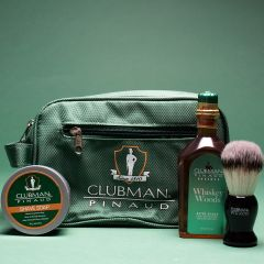 Clubman Shave Essentials Dopp Kit Bag flanked by Whisky Woods Shave Lotion, Shave Brush, & Shave Soap
