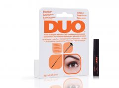 Slanted  Ardell DUO Brush-On Striplash Adhesive - Dark retail packaging side by side with DUO lash adhesive bottle